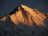 The sun slowly descends the south face of Cho Oyu (8201m), the sixth highest mountain in the world, at sunrise from Gokyo, turning the colour of the face from a golden yellow to extremely bright white within a few minutes.