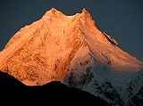 Manaslu southwest face sunrise from Syala