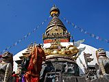 The first sight on reaching the top of the stairs is the Swayambhunath stupa flanked by two snow lions, with a giant gilded vajra above a mandala worked in a drum-shaped base. The earliest record of this stupa's existence dates from a 5C stone inscription; however, scholars and archaeologists believe that there was probably a shrine here as far back as 2,000 years ago.