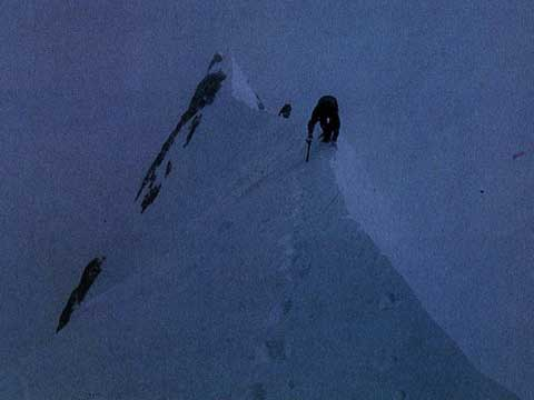 Reinhold Messner photographs Sher Khan and Nazir Sabir as they approach Gasherbrum II Summit on July 24, 1982 - 3x8000 Mein grosses Himalaja-Jahr: Kangchendzoonga, Gasherbrum II, Broad Peak, Cho Oyu book