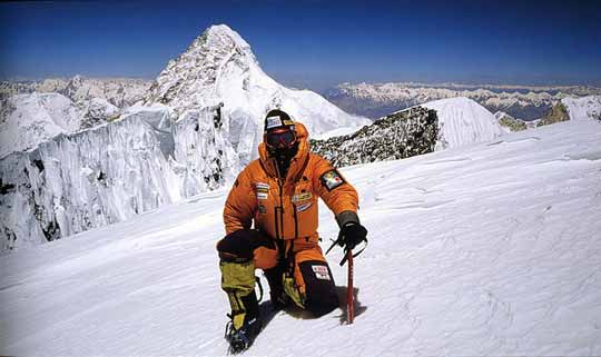Simone Moro on Broad Peak Summit July 15, 2003 with K2 behind - 8000 Metri Di Vita, 8000 Metres To Live For book