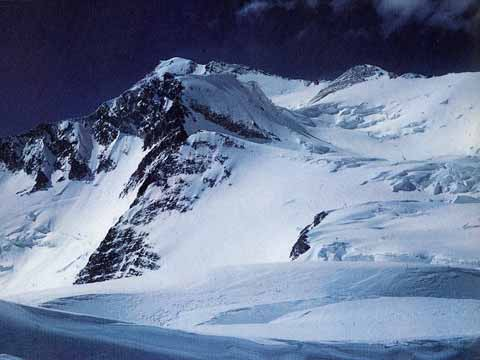 The summit of Gasherbrum I (Hidden Peak) from Camp IV in 1958, over 4,000 feet higher and miles of soft snow away. The first ascent route went up the plateau between Hidden South and Urdok Peak - A Walk In The Sky book