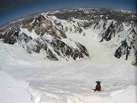 Michl Dacher climbs through deep snow to the K2 Shoulder, looking Northeast - All Fourteen 8000ers (Reinhold Messner) book