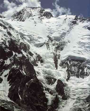 A huge ice avalanche come down from the middle of the almost 4400m high Nanga Parbat Diamir Face - All Fourteen 8000ers (Reinhold Messner) book