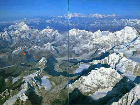 Leo Dickenson and Chris Dewhirst's balloon taking off from Gokyo October 21, 1991. Gauri Shankar and Menlungtse on the left; Shishapangma top middle-right; Cho Oyu on the right. - Ballooning Over Everest book