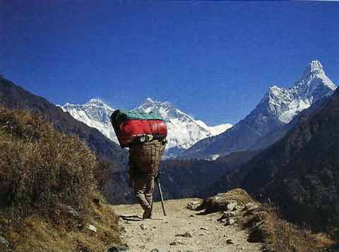 Porter with Everest, Lhotse and Ama Dablam - Everest North Face - Everest: A Trekkers Guide book