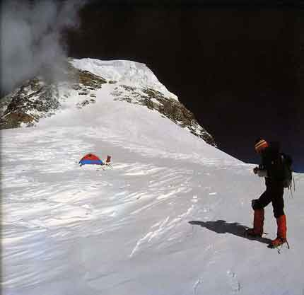 Reinhold Messner at Camp 4 on K2 Shoulder With Bottlebeck and route to summit above - K2: Mountain Of Mountains book