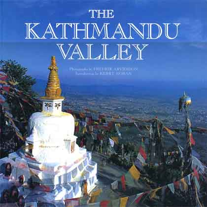 Prayer flags encircle the Buddhist shrine of Nagarjun Stupa to the north of Kathmandu - The Kathmandu Valley book cover