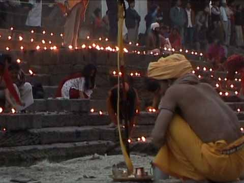 Lighting candles at Shivaratri Festival at Pashupatinath in Kathmandu - Le Tour des Annapurnas DVD