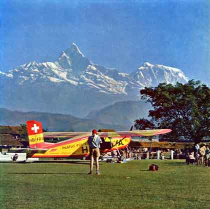 Pilatus-Porter airplane used to carry climbers, Sherpas, and supplies from Pokhara to the Dambush Pass at 5200m, with Machupuchare in background - The Ascent Of Dhaulagiri book