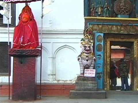 Kathmandu Durbar Square Hanuman statue and Hanuman Dhoka entrance - The Three Royal Cities Of Nepal DVD