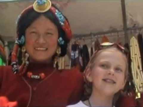 Young son and daughter on Jokhang roof with Potala Palace behind - Tibet An Adventure With Our Children Youtube Video by Ed van der Kooy and Piet Warffemius