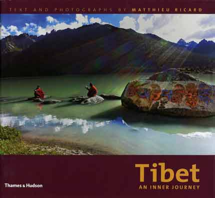 Monks at the lake of Yilung Lhatso near Derge, with Om Mani Padme Hum on the rock - Tibet An Inner Journey book cover