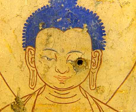 Buddha painting with bullet hole in eye - Tibet Cry Of The Snow Lion DVD