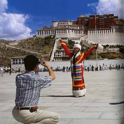 Chinese Tourist Poses In Tibetan Costume In Front Of Potala Palace In Lhasa - Tibet: Escape From The Roof Of The World by Dieter Glogowksi book