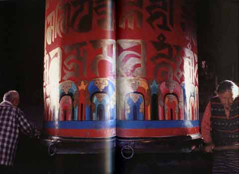 Pilgrims turning large prayer wheel - Tibetan Buddhist Life book