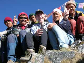 Jerome Ryan, Nepalese guide Gyan Tamang and our 4-person trekking crew at Sinion La on the Kangchenjunga trek
