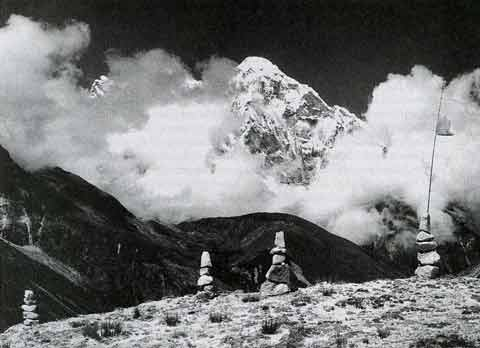 Afternoon thermal clouds rise around Gauri Shankar, viewed from Menluntgse Base Camp in Tibet - Trekking in Tibet: A Traveler's Guide book