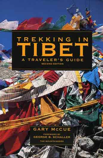 Prayer flags on Dolma La on Mount Kailash Kora - Trekking in Tibet: A Traveler's Guide book cover