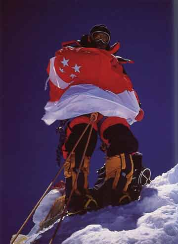 Edwin Siew Holding Singapore's National Flag On Shishapangma Central Summit May 16, 2002 - Xixabangma An Alpine Ascent of the North Ridge book
